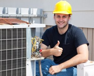 Smiling HVAC repairman looks like he just finished a successful air conditioning repair.