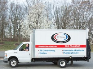 The picture is of a larger size DM Select Services truck with a smiling driver.