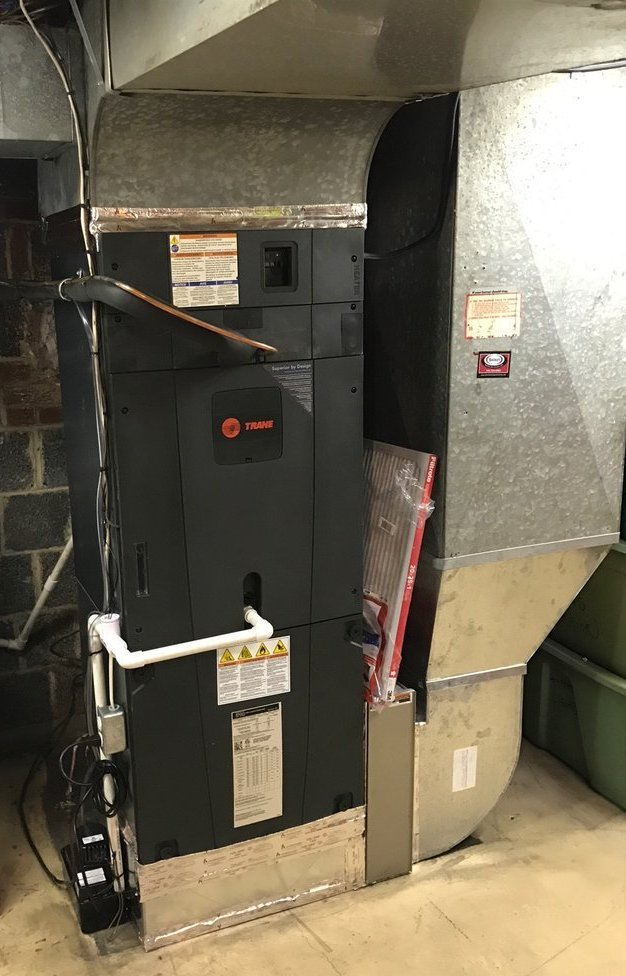 A new basement furnace installation, looking clean and safe.