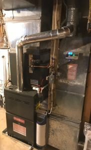 Clean and tidy, new furnace installation by DM Select Services.