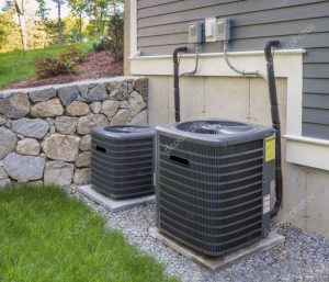 Air conditioning unit and compressor installed outside of the house.